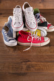 Multicolored youth gym shoes on floor Royalty Free Stock Image