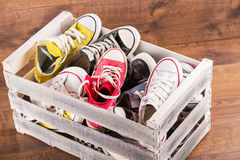 Multicolored youth gym shoes on floor Royalty Free Stock Photography