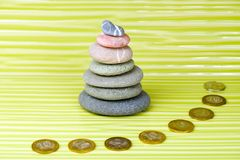 Multicolored zen stones and coins stock photography