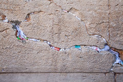 Multicolors notes in a gap of the wailing wall. Praying notes to God in a gap of the wailing wall Royalty Free Stock Photos