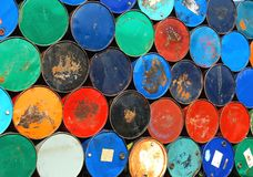 Multicolors old rusty oil barrels stack in rows.  Stock Image