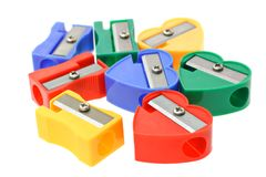 Multicolors pencil sharpeners. Close up of multicolors pencil sharpeners on white background Royalty Free Stock Images
