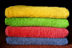 Multicolors towels. Colored terry towels - yellow, green, pink and blue Royalty Free Stock Images