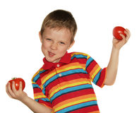 Multicolour boy. And tomatoes isolated backgrounds Stock Image
