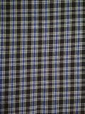Multicolour check texture on the cloths and garments. Texture ,garments,cloths,black blue white colour royalty free stock image