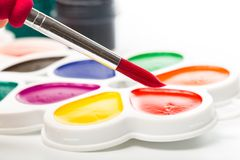Multicolour paints on white, gouache, brush. Multicolour paints on white, gouache, brush stock images