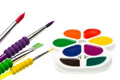 Multicolour paints on white, gouache with brush. Multicolour paints on white, gouache, brush royalty free stock photo