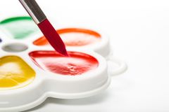 Multicolour paints on white, gouache, brush.  royalty free stock image