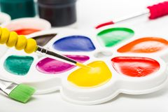 Multicolour paints on white, gouache, brush.  stock images