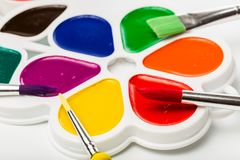 Multicolour paints on white, gouache, brush.  royalty free stock photos
