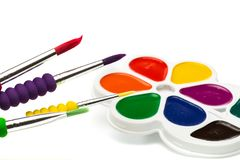 Multicolour paints on white, gouache, brush.  royalty free stock photography
