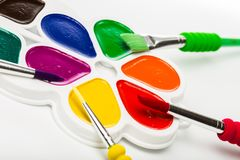 Multicolour paints on white, gouache, brush.  royalty free stock photo