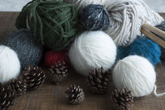 Multicoloured balls of wool, wood knitting needles Royalty Free Stock Photography