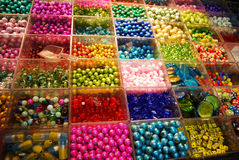 Multicoloured beads in bijouterie shop Royalty Free Stock Photos