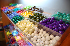 Multicoloured beads in boxes for sale Royalty Free Stock Image