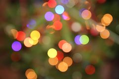 Multicoloured blurred Christmas lights stock photography
