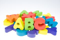 Multicoloured bright wooden letters Stock Images