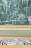 Multicoloured chalk and chalkboard Royalty Free Stock Photo