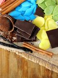 Multicoloured chocolate and ingredients for dessert cooking Stock Photography