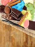 Multicoloured chocolate and ingredients for dessert cooking Stock Image