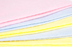 Multicoloured cleaning rags. Multicoloured stacked cleaning rags, abstract background Stock Photography