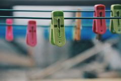 Multicoloured clothespins on the clothesline. Colourful pegs. selective focus Royalty Free Stock Images