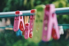 Multicoloured clothespins on the clothesline. Colourful pegs. selective focus Stock Photo