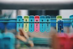Multicoloured clothespins on the clothesline. Colourful pegs. selective focus Royalty Free Stock Image