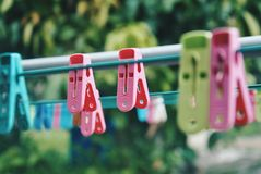 Multicoloured clothespins on the clothesline. Colourful pegs. selective focus Stock Image