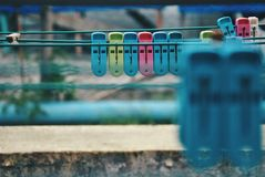 Multicoloured clothespins on the clothesline. Colourful pegs. selective focus Royalty Free Stock Photos