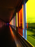 Multicoloured corridor. Airport terminal foot passenger corridor with multicoloured windows Royalty Free Stock Photo