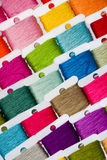 Multicoloured cotton threads. A selection of brightly coloured cotton threads on bobbins royalty free stock photo
