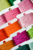Multicoloured cotton threads. A selection of brightly coloured cotton threads on bobbins stock photography