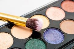 Multicoloured crumbled eye shadows. Stock Photos