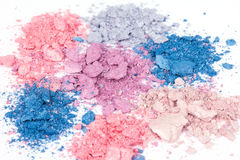 Multicoloured crumbled eyeshadows. Colour crumbled eyeshadows, closed-up on white Stock Image