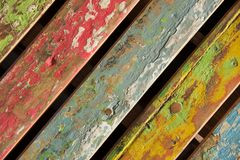 Multicoloured distressed chair back at an angle Stock Image