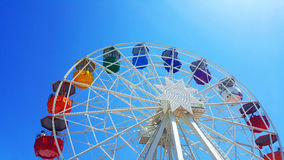 Multicoloured ferris wheel in Barcelona, Spain. Multicoloured ferris wheel, at the Tibidabo amusement park in Barcelona Royalty Free Stock Images
