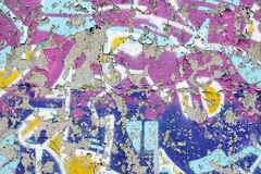 Multicoloured grungy peeling graffiti Royalty Free Stock Photo