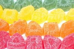 Multicoloured gumdrops background Stock Photos