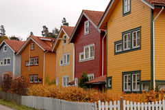Multicoloured Houses. A row of residential houses, painted in various colours Stock Photo