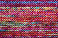Multicoloured knitted wool background. Multiple rows of garter stitch Royalty Free Stock Photo