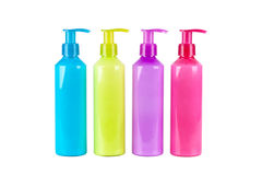 Multicoloured Lotion bottles Stock Photography