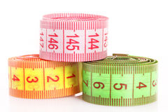 Multicoloured  measuring tapes  isolated Royalty Free Stock Image