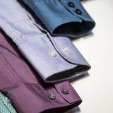 Multicoloured men's shirts Stock Photos
