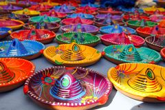 Multicoloured Mexican Sombrero Hat Ashtrays on Tepot. Multicoloured Traditional Mexican Sombrero Hat Ashtrays on Tepotzlan Market Stall Stock Photography