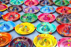 Multicoloured Mexican Sombrero Hat Ashtrays on Tepot. Multicoloured Traditional Mexican Sombrero Hat Ashtrays on Tepotzlan Market Stall Stock Photo