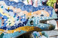Multicoloured mosaic dragon fountain in the Park Guell. Barcelona, Spain. stock photo