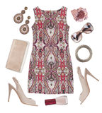 Multicoloured patterned dress, shoes, cosmetic and accessories isolated on white Royalty Free Stock Image