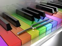 The multicoloured piano. Illustration of a silver tuning fork on a multicoloured piano Stock Image