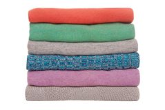 Multicoloured pile of sweaters Stock Photo